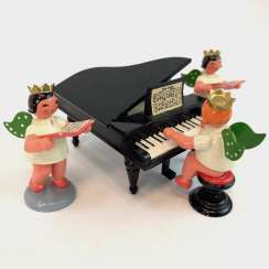 The post Christmas characters: three angels with piano. Very good.