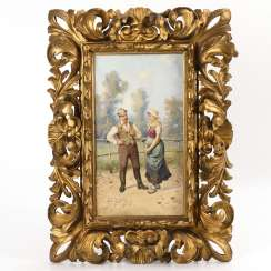 Magnificent carved frame with an amorous scene