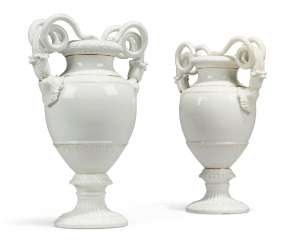 A PAIR OF MEISSEN PORCELAIN WHITE TWO-HANDLED VASES