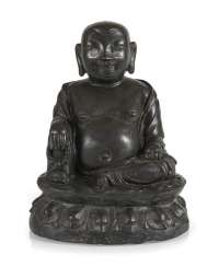 A Bronze sculpture of a seated Budai