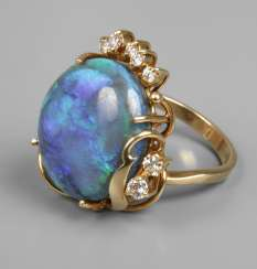 Ladies ring with opal and diamonds