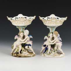 2 centerpieces with pairs of putti
