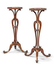 A PAIR OF GEORGE II MAHOGANY TORCHERES