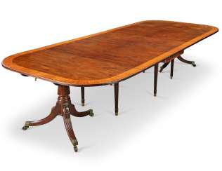 A GEORGE III STYLE SATINWOOD, TULIPWOOD AND KINGWOOD-CROSSBANDED MAHOGANY TWIN-PEDESTAL DINING-TABLE