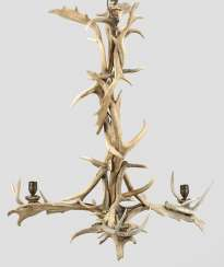 A Large Chandelier Made Of Antlers