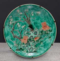 Large round plate with rocks and flowers decor in the colours of the 'Famille verte'