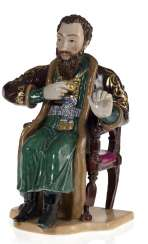 A Rare Large Porcelain Figurine of a Draughts Player
