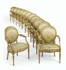 A SET OF TWELVE GEORGE III STYLE GILTWOOD ARMCHAIRS