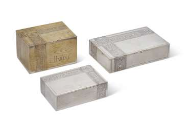 TWO RUSSIAN PARCEL-GILT SILVER AND ONE SILVER-PLATE TROMPE L'OEIL CIGAR BOXES