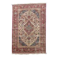 Oriental rug made of silk. 20. Century, approx. 196x130 cm.