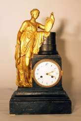 Austrian or Italian apothecary clock with the goddess of Hygieia in classical dress lining on a shield with a snake on a column