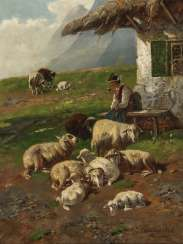 Shepherd with sheep in front of the hut