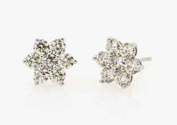 A pair of flower-shaped stud earrings with diamonds Germany