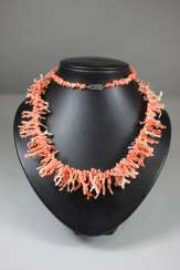 Coral necklace, coral sticks and branches