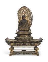 A CARVED SEATED WOOD FIGURE OF AMITABHA (AMIDA NYORAI)