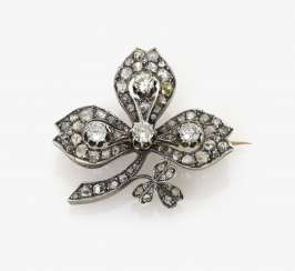 Brooch in the Form of a pinnate leaf with diamonds. Paris, 1880