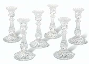 A GROUP OF SIX BACCARAT SPIRAL-MOLDED GLASS CANDLESTICKS