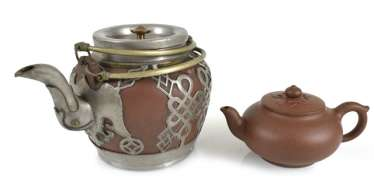 Two teapots made from Zisha-Ware, one with brass fittings