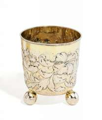Ball footed beaker with a floral relief