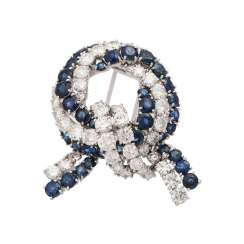Grinding brooch with sapphires and brilliant-cut diamonds, together approx 10 ct,