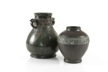 Two vases made of Bronze, with a silver Deposit