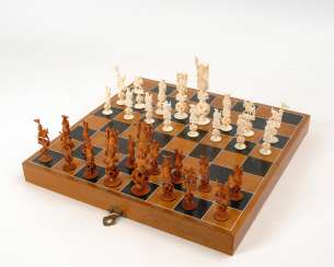 Chess game with ivory figures.