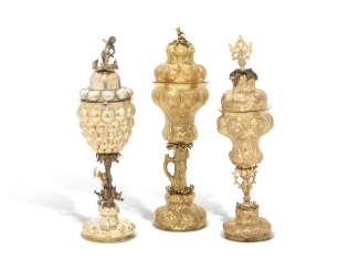A PARCEL-GILT SILVER PINEAPPLE CUP AND COVER AND TWO SILVER-GILT CUPS AND COVERS