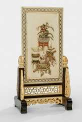 Finely carved table control screen is made of ivory with antique relief