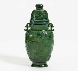 Lidded vase with dragon relief