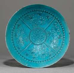 Turquoise glazed bowl made of ceramic with sculpted decor of flowers