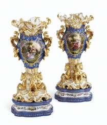 A PAIR OF JACOB PETIT PORCELAIN BLUE AND GOLD GROUND RETICULATED VASES ON STANDS