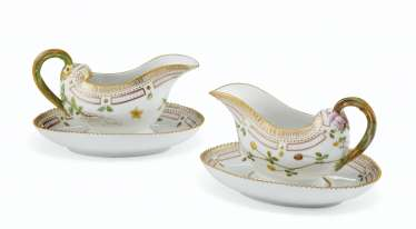 A PAIR OF ROYAL COPENHAGEN PORCELAIN 'FLORA DANICA' SAUCEBOATS ON FIXED STANDS