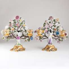 A pair of extraordinary ormolu candlesticks with Meissen figurines
