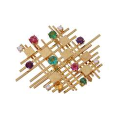 Modern brooch with precious stones,