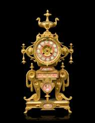 A NAPOLEON III 'NEO-GREC' ORMOLU AND PINK-GROUND PORCELAIN MANTEL CLOCK
