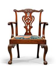 A GEORGE II MAHOGANY OPEN ARMCHAIR