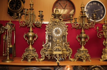 mantel clock with 2 candelabra