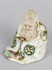 Chinese Porcelain figure of a wise men with script-role and coat