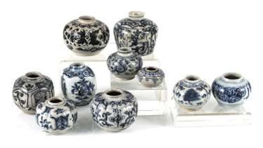 Group of ten small shoulder pots with blue-white decor