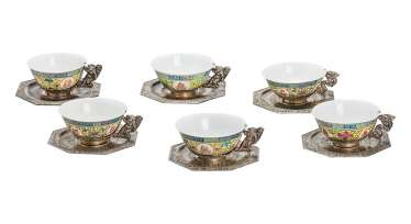 Six Famille jaune cups and saucers with silver mounts