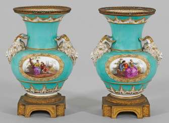 Pair of ornamental vases with rams ' heads