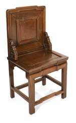 Hard wood chair with burl wood inlay in the backrest