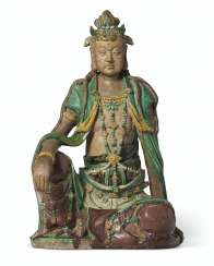 A LARGE GLAZED TILEWORKS FIGURE OF SEATED GUANYIN
