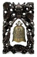 Bronze bell with dragon decoration in carved wood frame with silver deposits
