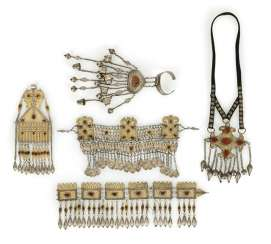Group of chest ornaments, headbands and hand rosette made of partially gold-plated silver