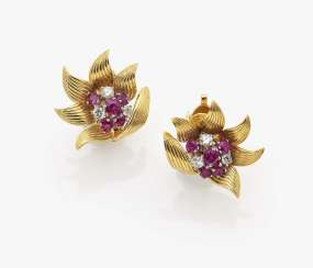 A pair of flower-shaped ear clips with rubies and diamonds New York, 1940s, PREFORMED PARTS