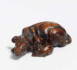 Netsuke: Lying cow with calf