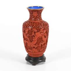 Red lacquer vase on a wooden base