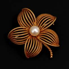Flower brooch with cultured pearl.