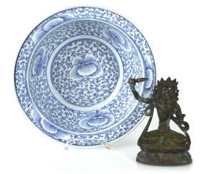 Blue-and-white decorated porcelain bowl and a small Bronze of Manjushri